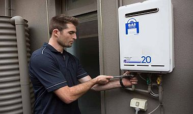 Fred, one of our Turlock water heater repair pros, is repairing a tankless unit